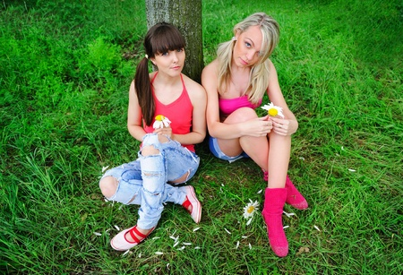 two pretty girls relaxing outdoor photo