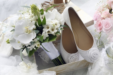 Bridal bouquet and bride shoes. photo