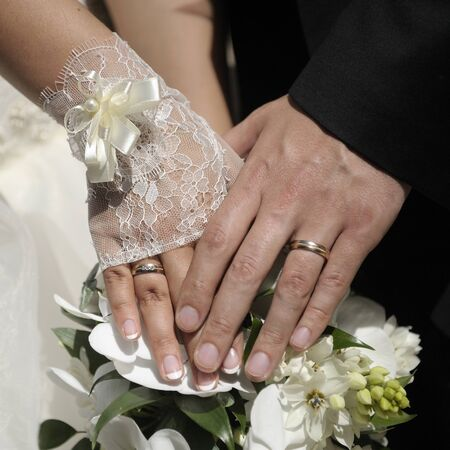 Just married couple hands with flowers. Stock Photo - 9715458