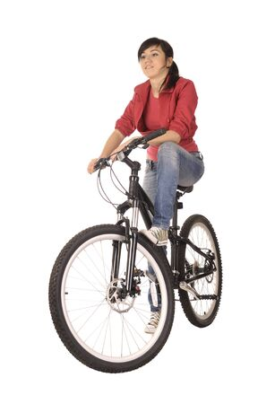 Young woman bicyclist isolated on white, studio shot. photo