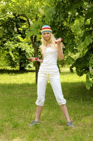 Young sporty woman is working out outdoor.  Stock Photo - 9999661