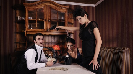 Gangsters who share the money, women wants to shoot the guy. Stock Photo - 9999665