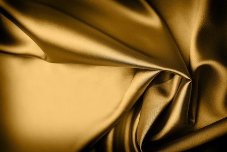 Smooth gold silk background with place for text photo