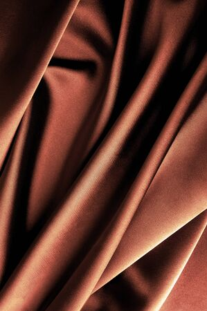 Smooth elegant brown satin background. photo