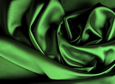 Smooth elegant dark green satin background. photo