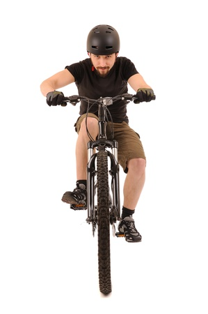 rapidity: Riding bicyclist isolated on white, studio shot
