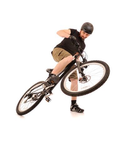 rapidity: Riding bicyclist isolated on white, studio shot