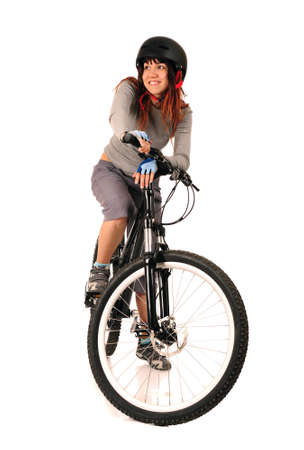Young smiling woman bicyclist isolated on white, studio shot  photo