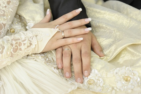 wed: Just married couple hands. Focus on a bride hand.