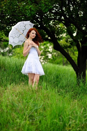 one teenager: Happy girl portrait, walking with umbrella in park  Outdoor