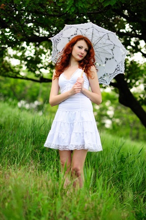 Happy girl portrait, walking with umbrella in park  Outdoor   photo