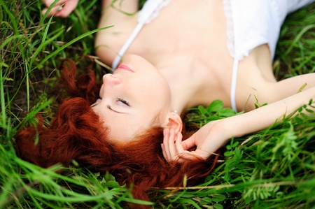 Resting girl portrait, lying in grass field  Outdoor Stock Photo - 13184294