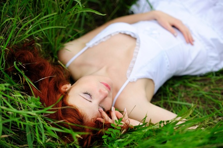 Resting girl portrait, lying in grass field  Outdoor   photo