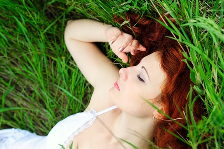 Resting girl portrait, lying in grass field  Outdoor Stock Photo - 13184309