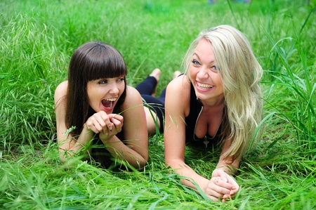 Two beautiful young women friends having fun outdoor. photo