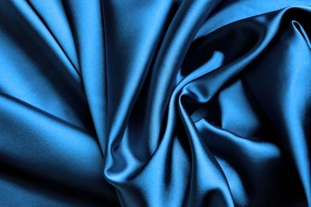 raso: Liscio elegante sfondo blu satinato. Archivio Fotografico