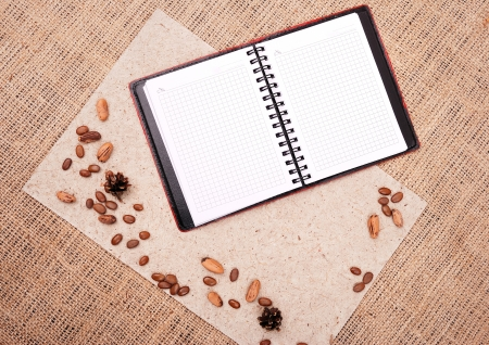 open notebook with nature elements on background of sacking  photo