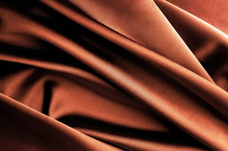 Smooth elegant brown satin background  photo
