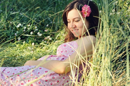 Beautiful pregnant woman relaxing on grass. Stock Photo - 17543623