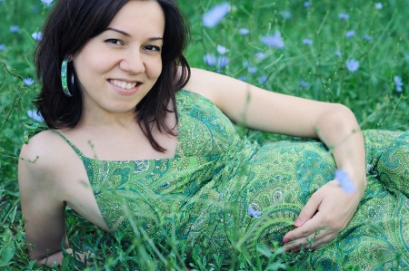 Beautiful pregnant woman portrait relaxing on grass. Stock Photo - 17543629