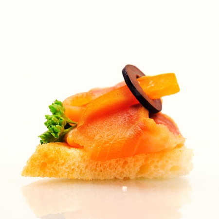 amuse: Sandwich on wheat bread with salmon, paprika and olive.