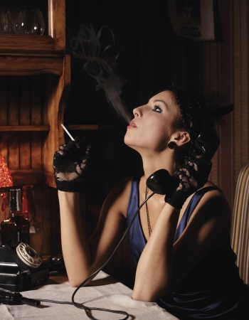 gangster girl: Woman portrait  in retro style, smoking and talking by phone