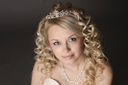 Portrait of a beautiful young woman dressed as a bride  photo