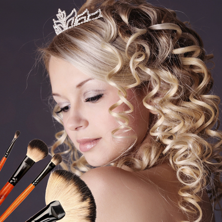 Wedding makeup portrait with brushes  photo