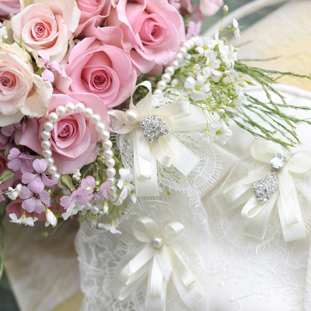 Wedding bouquet of roses and pearl necklace. photo