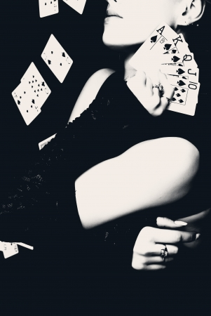 Sexy woman holding playing cards, retro style photo. photo