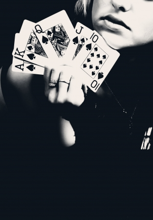 Woman holding playing cards, retro style photo. photo