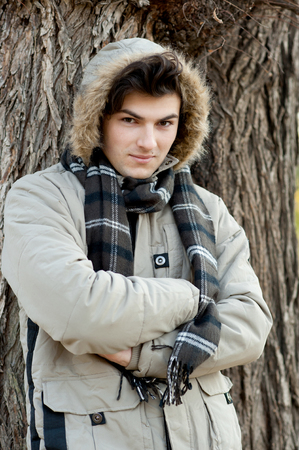 Young stylish man portrait in winter park. Outdoor. photo