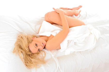 hot girl lying: Bright picture of laying in bed blonde sexy woman.