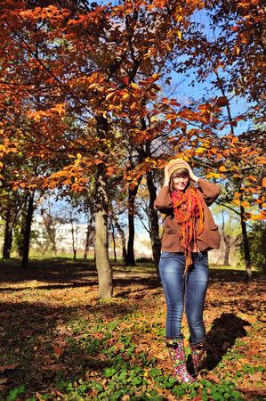 Portrait of a cute girl hiking in park, autumn autdoor. photo