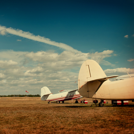 Planes stand against the autumn field. photo