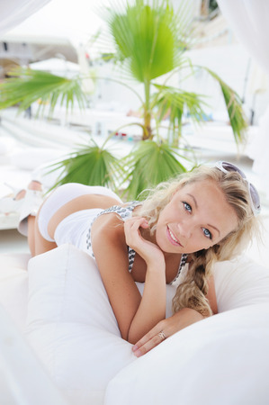 Portrait of sexual young woman in tropical sea beach club. photo