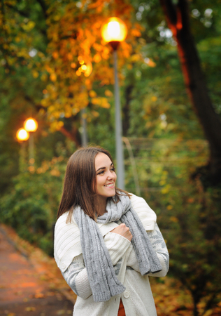knitted jacket: Autumn outdoor portrait of a smiling woman wearing knitted jacket.