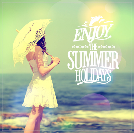 Enjoy the summer holidays quote card with girl in white dress with lacy umbrella on a sea beach photo