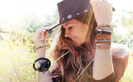 bohemia: Fashion smiling woman portrait with hat on a head, sunny backlit outdoor photo, boho chic style, hipster style