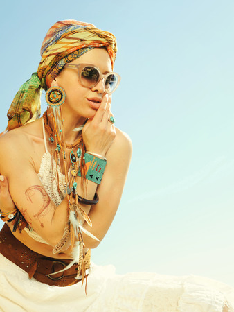 copies: Hot boho chic beautiful woman portrait, sunny backlit outdoor photo against sky, copy space for text