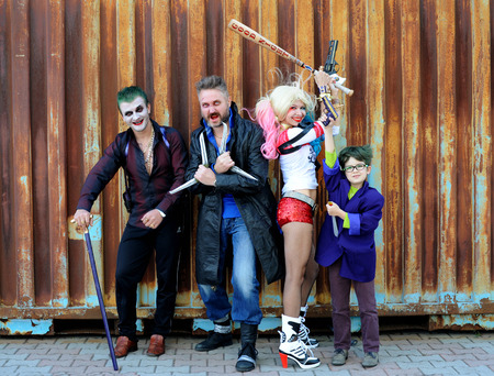 funny guys: UKRAINE, ODESSA - August 13, 2016: Cosplayer girl in Harley Quinn costume and cosplayer men in Joker and Boomerang costumes during Fan Expo Odessa, Comic Con Editorial