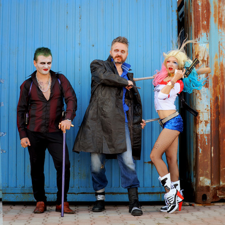 named person: Cosplayer girl in Harley Quinn costume and cosplayer men in Joker and Boomerang costumes