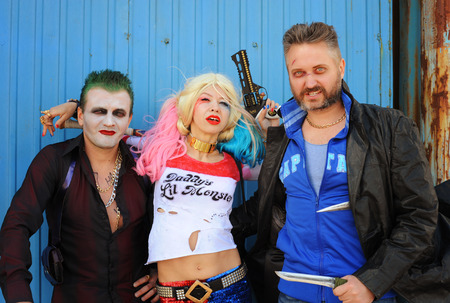 named person: UKRAINE, ODESSA - August 13, 2016: Cosplayer girl in Harley Quinn costume and cosplayer men in Joker and Boomerang costumes during Fan Expo Odessa, Comic Con Editorial