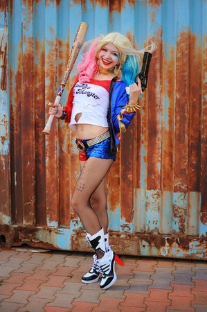 Cosplayer girl posing in Harley Quinn costume