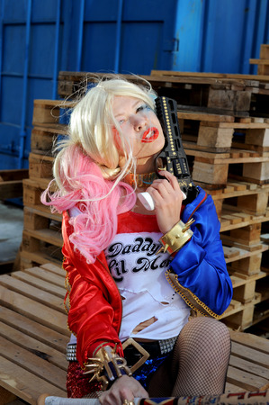 named person: Cosplayer girl posing in Harley Quinn costume