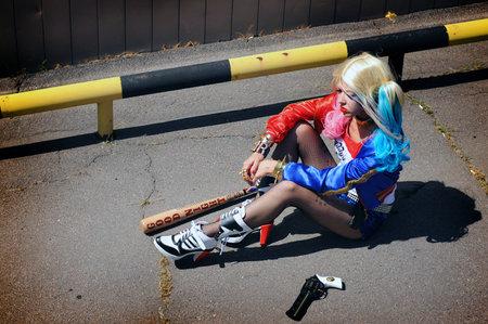 Cosplayer girl posing in Harley Quinn costume