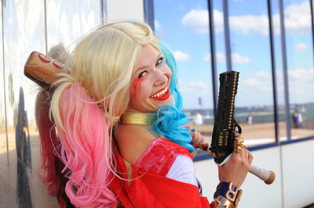 cocky: Cosplayer girl posing in Harley Quinn costume
