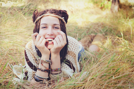 seson: Boho style smiling woman portrait, girl have a fun lying outdoor in autumn sunny park, natural lifestyle concept Stock Photo
