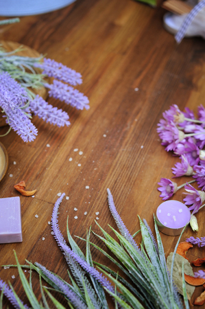 Rustic wooden backdrop with aromatic meadow herbs and lavender, body care organic concept, copy space for text
