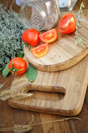 Background with cherry tomatoes on a rustic old wooden table